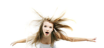 Young girl falling down, over white Royalty Free Stock Photo
