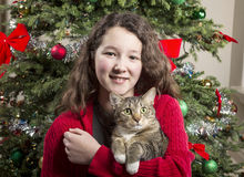 Young Girl with Family Pet during Holidays Royalty Free Stock Photos
