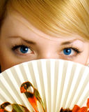 Young girl with fan Royalty Free Stock Photo