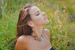 Young girl with fancy necklace and earrings Royalty Free Stock Images