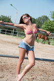 Young girl in the farm farm with top bikini and shorts Royalty Free Stock Photography