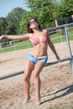 Young girl in the farm farm with top bikini and shorts. Young girl in the farm, wear sunglasses , short jean and bra posing outside of the horse fenced area Stock Photos