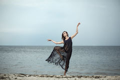 Young girl in a fashionable blue cape dancing on the background Royalty Free Stock Image