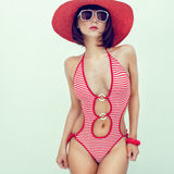 Young girl in fashionable swimsuit. Portrait of a young girl in fashionable swimsuit Royalty Free Stock Images