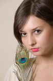 Young girl with feather. Studio shot Stock Images