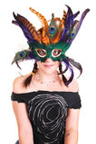 Young girl with feather mask. Stock Photo