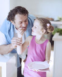Young girl feeding her father Royalty Free Stock Images