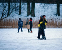 Young girl and fellow hug each other at the rink. Young girl and fellow hug eath other at the winter rink covered with snow in Trakai, Lithuania Stock Photography
