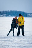 Young girl and fellow ice skating in Trakai Lithuania Stock Photo
