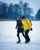 Young girl and fellow ice skating in Trakai of Lithuania Stock Photos