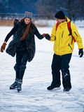 Young girl and fellow ice skating Trakai Lithuania Royalty Free Stock Photo