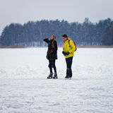 Young girl and fellow ice skating in Trakai Royalty Free Stock Images
