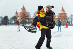 Young girl and fellow at rink in Trakai Royalty Free Stock Photography