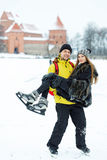 Young girl and fellow at rink in winter Trakai Royalty Free Stock Images