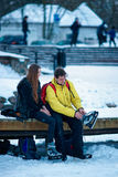 Young girl and fellow wearing skates in Trakai in Lithuania Royalty Free Stock Images