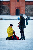Young girl and fellow at winter rink in Trakai Lithuania Stock Image