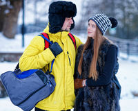 Young girl and fellow in winter in Trakai Royalty Free Stock Images