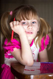 Young girl with felt-tip pen Stock Photography