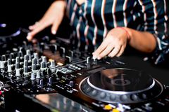Young girl female shot party dj audio controlling mixing. Turntable High quality Sound mixing controller disc jockey hands of woma. N in night club party, Pro stock photo