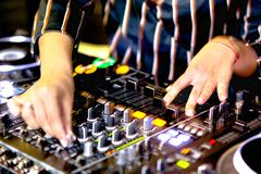 Young girl female shot party dj audio controlling mixing. Turntable High quality Sound mixing controller disc jockey hands of woma. N in night club party, Pro royalty free stock image