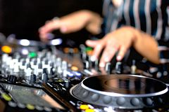Young girl female shot party dj audio controlling mixing. Turntable High quality Sound mixing controller disc jockey hands of woma. N in night club party, Pro royalty free stock images