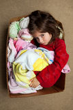 Young Girl With Fever Rash Cuddling in a Box with Stuffed Animal. A young girl with a fever rash, after receiving an MMR vaccine, curls up in a box to cuddle Stock Photos