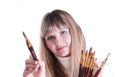 Young girl with few brushes Royalty Free Stock Photography