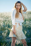 Young girl in field Royalty Free Stock Photo