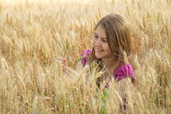Young girl in the field Royalty Free Stock Images