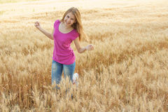 Young girl in the field Stock Photography