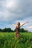 Young girl in field Royalty Free Stock Images