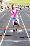 Young girl in field day race Stock Photo