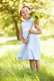 Young Girl In Field Holding Sunflower Stock Images