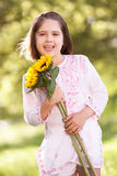 Young Girl Through Field Holding Sunflower Royalty Free Stock Image
