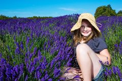 Young girl in a field of purple lavender Stock Photo