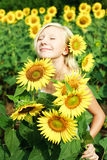 Young girl in the field of sunflowers Stock Photo