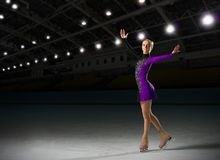 Young girl figure skater. In sports hall Royalty Free Stock Photos