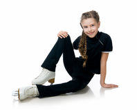 Young girl figure skating Stock Photos