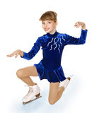 Young girl figure skating.. Stock Photos