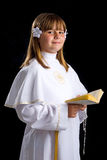 Young girl in first communion time Royalty Free Stock Photos