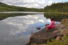 Young girl fishing Royalty Free Stock Images