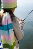 Young girl fishing. On a cold autumn morning royalty free stock photo