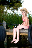 Young girl fishing at a lake Stock Image