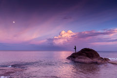 Young girl fishing at sunset Stock Photo