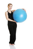 Young girl with fit ball Royalty Free Stock Photo