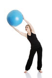 Young girl with fit ball Stock Images