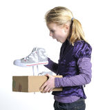 Young girl is flabbergasted over her new shoes. Young girl is flabbergasted over her brand new shoes Stock Image