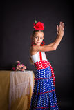 Young girl in flamenco outfit clapping hands Stock Photos