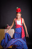 Young girl in flamenco outfit dancing Royalty Free Stock Image