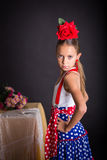 Young girl with flamenco outfit Stock Photos